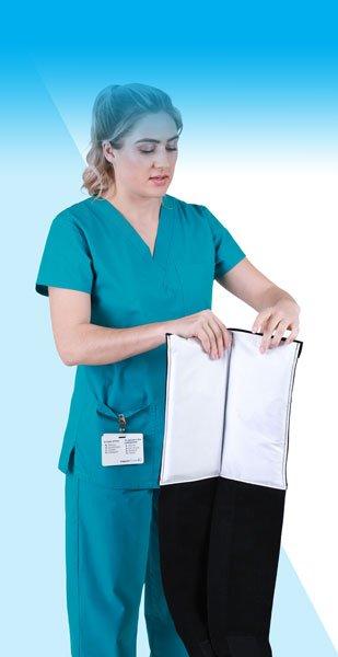 Nurse Securing Velcro Tabs on an SMI Wrap